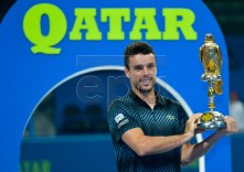 Roberto Bautista Agut of Spain celebrates with the trophy after winning the ATP Qatar Open Tennis tournament final against Tomas Berdych of Czech Republic at the Khalifa International Tennis Complex in Doha, Qatar, 05 January 2019. EPA-EFE/NOUSHAD THEKKAYIL