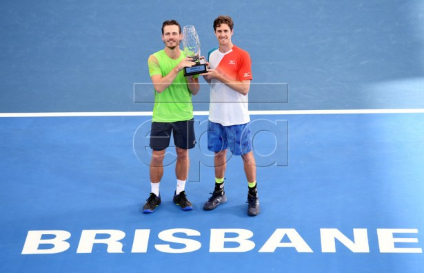 Wesley Koolhof of the Netherlands (L) and Marcus Daniell of New Zealand hold the trophy after winning their their men's doubles final against Rajeev Ram of the US and Joe Salisbury of Great Britain at the Brisbane International tennis tournament at the Queensland Tennis Centre in Brisbane, Australia, 06 January 2019. EPA-EFE/DAN PELED AUSTRALIA AND NE