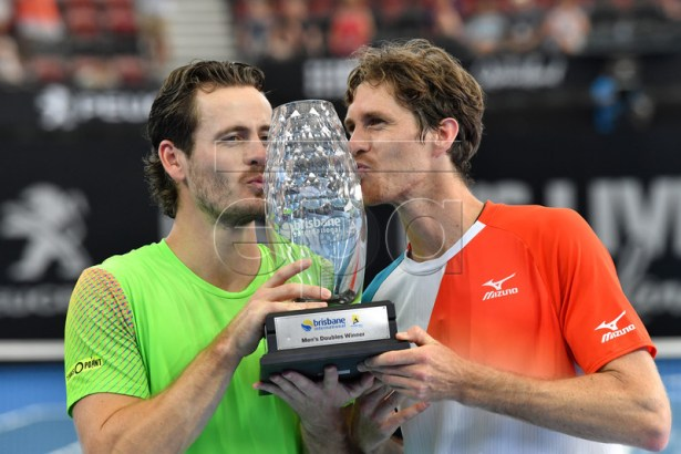 Wesley Koolhof (L) of the Netherlands and Marcus Daniell of New Zealand celebrate winning the men's doubles final against Rajeev Ram of the US and Joe Salisbury of Great Britain at the Brisbane International tennis tournament at the Queensland Tennis Centre in Brisbane, Australia, 06 January 2019. EPA-EFE/DARREN ENGLAND AUSTRALIA AND NEW ZEALAND OUT