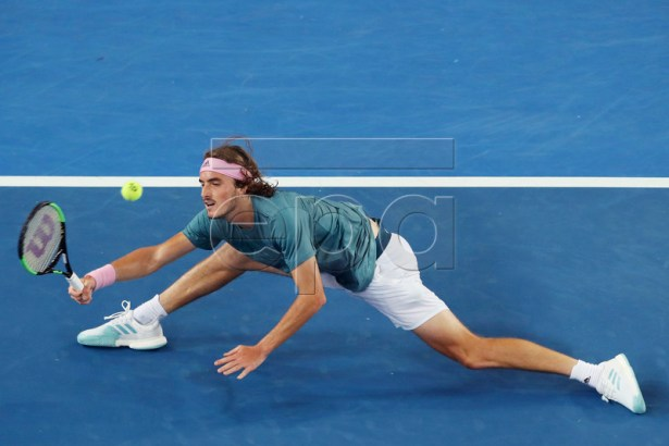 Stefanos Tsitsipas of Greece in action against Nikoloz Basilashvili of Georgia during their round three men's singles match at the Australian Open Grand Slam tennis tournament in Melbourne, Australia, 18 January 2019. EPA-EFE/DAVID CROSLING AUSTRALIA AND NEW ZEALAND OUT