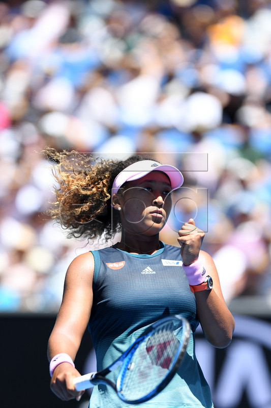 Naomi Osaka of Japan celebrates during the match against Su-Wei Hsieh of Taiwan on day six of the Australian Open Grand Slam tennis tournament in Melbourne, Australia, 19 January 2019. EPA-EFE/LUKAS COCH AUSTRALIA AND NEW ZEALAND OUT