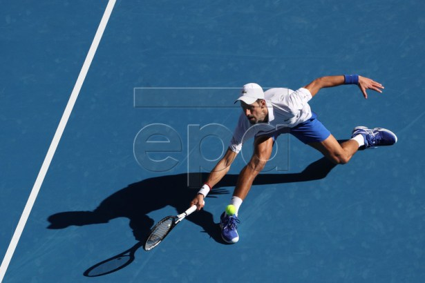 Novak Djokovic of Serbia in action against Denis Shapovalov of Canada during their round three men's singles match at the Australian Open Grand Slam tennis tournament in Melbourne, Australia, 19 January 2019.  EPA-EFE/DAVID CROSLING AUSTRALIA AND NEW ZEALAND OUT