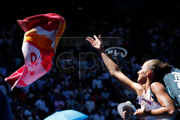 Karolina Pliskova of Czech Republic throws her towel to fans after winning her women's singles quarter final match against Serena Williams of the United Sates on day 10 of the Australian Open Grand Slam tennis tournament in Melbourne, Australia, 23 January 2019. EPA-EFE/RITCHIE TONGO