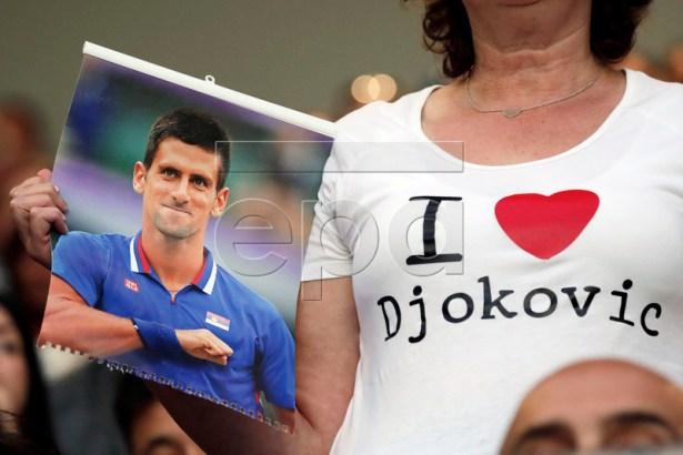 A fan shows her support for Novak Djokovic of Serbia during his men's singles quarter final match against Kei Nishikori of Japan at the Australian Open Grand Slam tennis tournament in Melbourne, Australia, 23 January 2019. EPA-EFE/LYNN BO BO