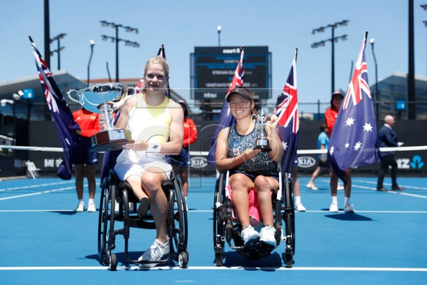 Diede De Groot (L) of Netherlands and Yui Kamiji (R) of Japan pose with their trophies after their women's singles wheelchair final match on day 13 of the Australian Open Grand Slam tennis tournament in Melbourne, Australia, 26 January 2019.  EPA-EFE/RITCHIE TONGO