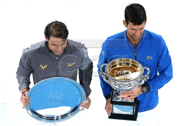 Novak Djokovic (R) of Serbia and Rafael Nadal of Spain pose with their trophies after the men's singles final  at the Australian Open Grand Slam tennis tournament in Melbourne, Australia, 27 January 2019.  EPA-EFE/HAMISH BLAIR EDITORIAL USE ONLY AUSTRALIA AND NEW ZEALAND OUT