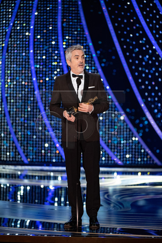 A handout photo made available by the Academy of Motion Picture Arts and Science (AMPAS) shows Alfonso Cuaron accepting the Oscar for achievement in cinematography during the 91st annual Academy Awards ceremony at the Dolby Theatre in Hollywood, California, USA, 24 February 2019. The Oscars are presented for outstanding individual or collective efforts in 24 categories in filmmaking. EPA-EFE/Aaron Poole / AMPAS / HANDOUT THE IMAGE MAY NOT BE ALTERED AND IS FREE FOR EDITORIAL USE ONY IN REPORTING ABOUT THE EVENT. ONE TIME USE ONLY. MANDATORY CREDIT. HANDOUT EDITORIAL USE ONLY/NO SALES
