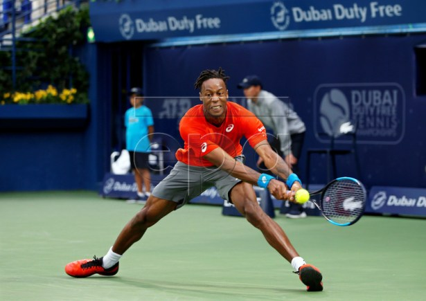 Gael Monfils of France in action against Marcos Baghdatis of Cyprus during their second round match at the Dubai Duty Free Tennis ATP Championships 2019 in Dubai, United Arab Emirates, 27 February 2019. EPA-EFE/ALI HAIDER