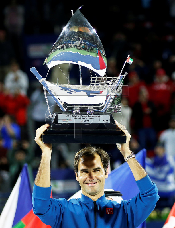 Roger Federer of Switzerland celebrates with his trophy after defeating Stefanos Tsitsipas of Greece in their final match at the Dubai Duty Free Tennis ATP Championships 2019 in Dubai, United Arab Emirates, 02 March 2019.  EPA-EFE/ALI HAIDER