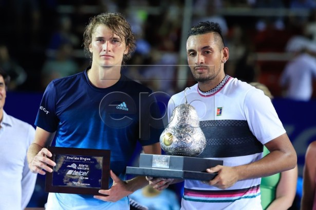 Australian tennis player Nick Kyrgios (R) celebrates with the trophy after winning the men's final of the Mexican Tennis Open, next to second place Alexander Zverev (L) of Germany, in Acapulco, Mexico, 02 March 2019.  EPA-EFE/DAVID GUZMAN CORIRGE NACIONALIDAD DE ZVEREV