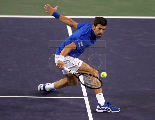 Novak Djokovic of Serbia in action against Bjorn Fratangelo of the US during the BNP Paribas Open tennis tournament at the Indian Wells Tennis Garden in Indian Wells, California, USA, 09 March 2019. The men's and women's final will be played on 17 March 2019.  EPA-EFE/JOHN G. MABANGLO