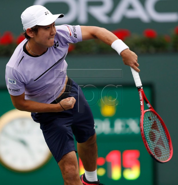 Yoshihito Nishioka of Japan in action against Felix Auger-Aliassime of Canada during the BNP Paribas Open tennis tournament at the Indian Wells Tennis Garden in Indian Wells, California, USA, 11 March 2019. The men's and women's final will be played on 17 March 2019.  EPA-EFE/JOHN G. MABANGLO