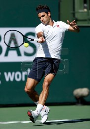 Roger Federer of Switzerland in action against Kyle Edmund of Great Britain during the BNP Paribas Open tennis tournament at the Indian Wells Tennis Garden in Indian Wells, California, USA, 13 March 2019. The men's and women's final will be played, 17 March 2019.  EPA-EFE/JOHN G. MABANGLO