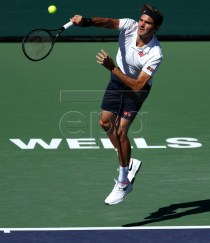Roger Federer of Switzerland serves against Kyle Edmund of Great Britain during the BNP Paribas Open tennis tournament at the Indian Wells Tennis Garden in Indian Wells, California, USA, 13 March 2019. The men's and women's final will be played, 17 March 2019.  EPA-EFE/JOHN G. MABANGLO