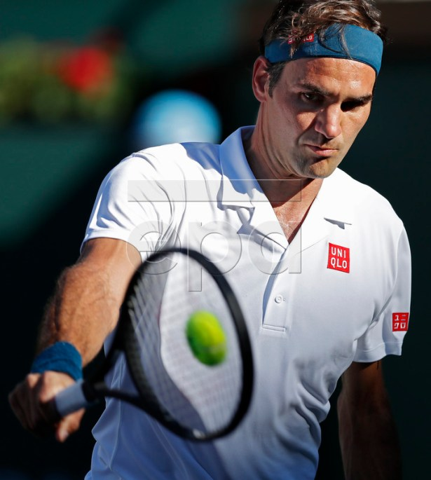 Roger Federer of Switzerland in action against Dominic Thiem of Austria during the Finals at the BNP Paribas Open tennis tournament at the Indian Wells Tennis Garden in Indian Wells, California, USA, 17 March 2019.  EPA-EFE/JOHN G MABANGLO