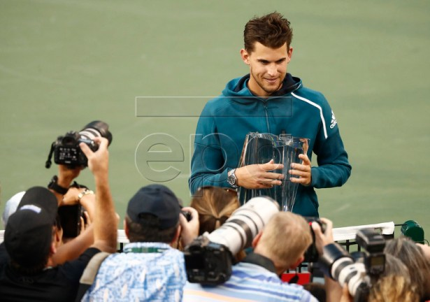 Dominic Thiem of Austria poses with the trophy after beating Roger Federer of Switzerland during the finals of the BNP Paribas Open tennis tournament at the Indian Wells Tennis Garden in Indian Wells, California, USA, 17 March 2019. EPA-EFE/LARRY W. SMITH