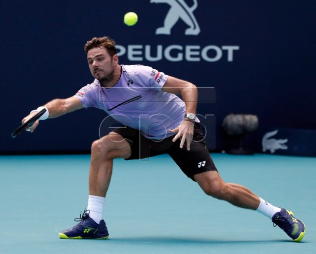 Stan Wawrinka of Switzerland in action against Filip Krajinovic of Serbia during their match at the Miami Open tennis tournament in Miami, Florida, USA, 23 March 2019.  EPA-EFE/JASON SZENES