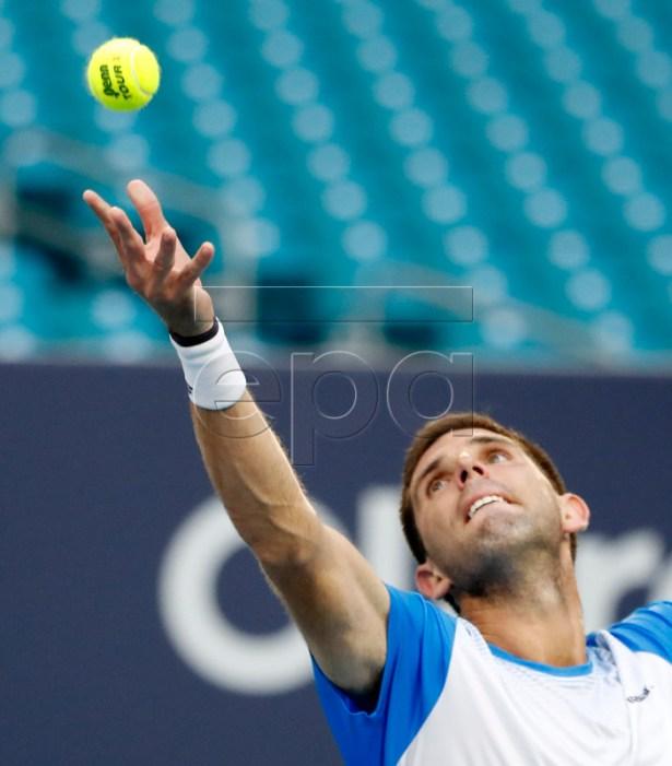 Federico Delbonis of Argentina in action against Novak Djokovic of Serbia during their men's singles match at the Miami Open tennis tournament in Miami, Florida, USA, 24 March 2019.  EPA-EFE/JASON SZENES