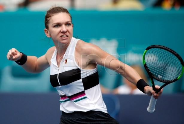 Simona Halep of the Romania reacts after defeating Polona Hercog of Slovenia in three sets during their women's singles match at the Miami Open tennis tournament in Miami, Florida, USA, 24 March 2019.  EPA-EFE/JASON SZENES