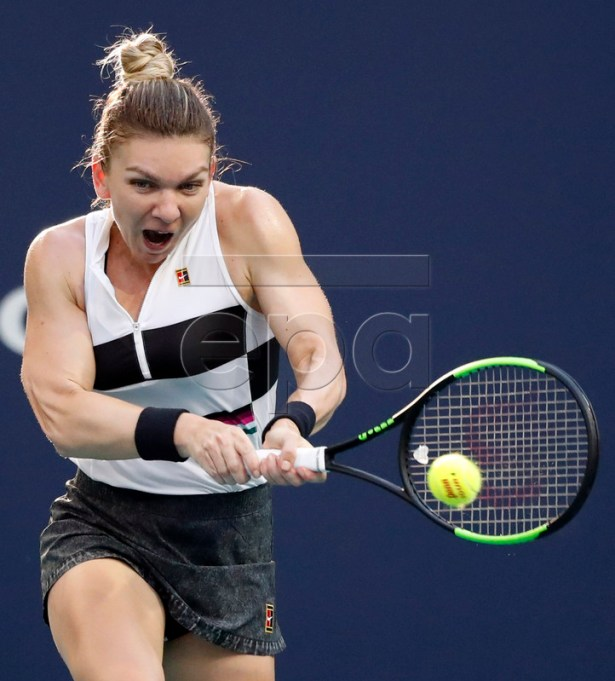 Simona Halep of Romania in action against Venus Williams of the US during their women's singles match at the Miami Open tennis tournament in Miami, Florida, USA, 25 March 2019.  EPA-EFE/JASON SZENES
