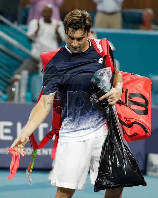 David Ferrer of Spain drops his headband on the court after his match against Frances Tiafoe of the USA at the Miami Open tennis tournament in Miami, Florida, USA, 25 March 2019.  EPA-EFE/RHONA WISE
