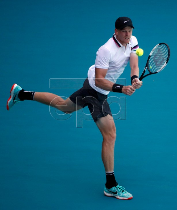 Kyle Edmund of Great Britain in action against John Isner of the US during their men's singles match at the Miami Open tennis tournament in Miami, Florida, USA, 26 March 2019.  EPA-EFE/JASON SZENES