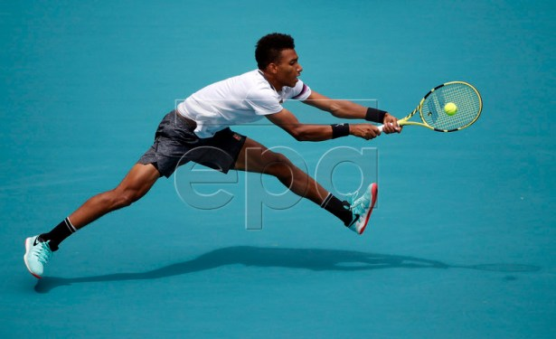 Felix Auger Aliassime of Canada in action against John Isner of the US during their men's semifinals match at the Miami Open tennis tournament in Miami, Florida, USA, 29 March 2019.  EPA-EFE/JASON SZENES