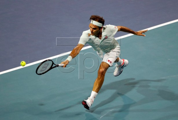Roger Federer of Switzerland in action against Denis Shapovalov of Canada during their men's semifinals match at the Miami Open tennis tournament in Miami, Florida, USA, 29 March 2019.  EPA-EFE/JASON SZENES