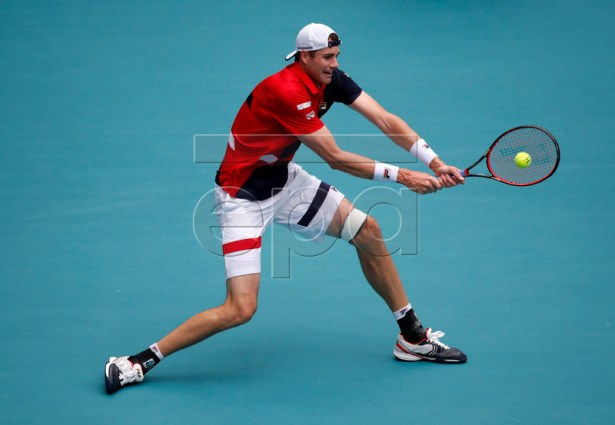 John Isner of the US in action against  Roger Federer of Switzerland during their Men's finals match at the Miami Open tennis tournament in Miami, Florida, USA, 31 March 2019.  EPA-EFE/JASON SZENES