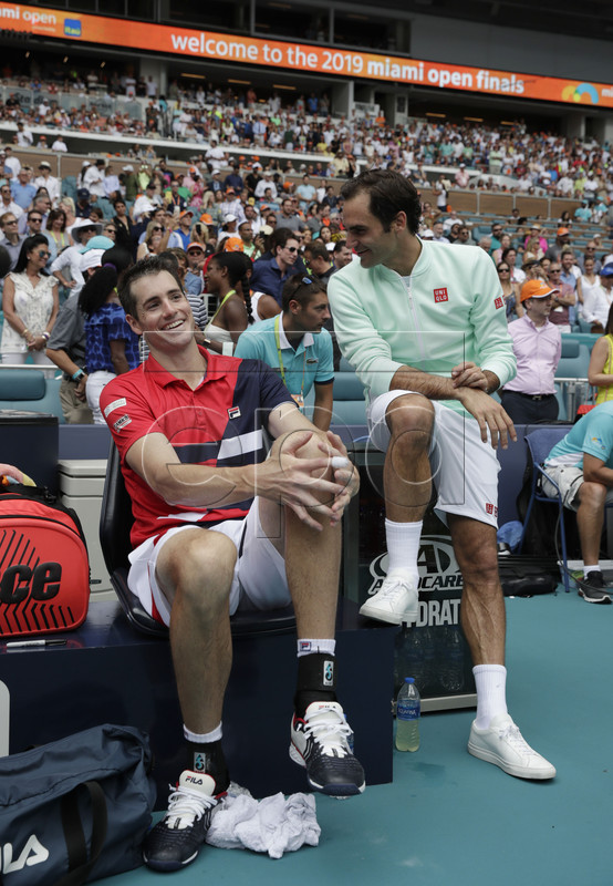 Roger Federer of Switzerland (R) and John Isner of the US (L) talk on the bench following their Men's finals match at the Miami Open tennis tournament in Miami, Florida, USA, 31 March 2019.  EPA-EFE/JASON SZENES