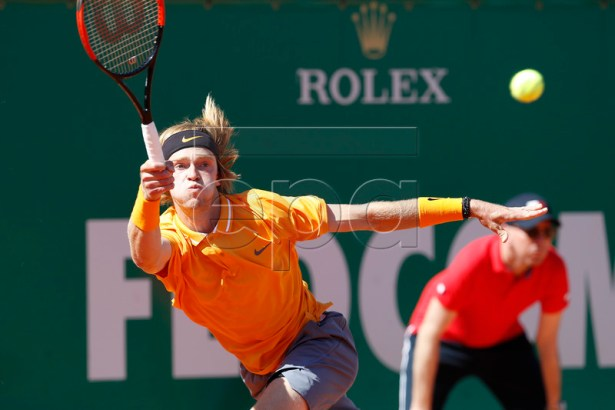 Andrey Rublev of Russia in action during his first round match against Fabio Fognini of Italy at the Monte-Carlo Rolex Masters tournament in Roquebrune Cap Martin, France, 15 April 2019.  EPA-EFE/SEBASTIEN NOGIER