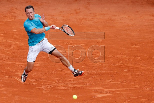 Philipp Kohlschreiber of Germany in action during his second round match against Novak Djokovic of Serbia at the Monte-Carlo Rolex Masters tournament in Roquebrune Cap Martin, France, 16 April 2019.  EPA-EFE/SEBASTIEN NOGIER