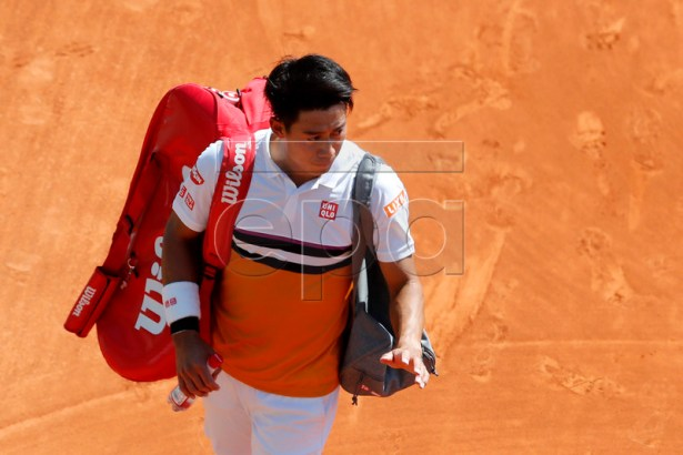 Kei Nishikori of Japan leaves the court after losing to Pierre-Hugues Herbert of France in their second round match at the Monte-Carlo Rolex Masters tournament in Roquebrune Cap Martin, France, 17 April 2019. EPA-EFE/SEBASTIEN NOGIER