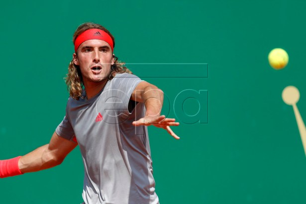 Stefanos Tsitsipas of Greece returns the ball to Daniil Medvedev of Russia during their third round match at the Monte-Carlo Rolex Masters tournament in Roquebrune Cap Martin, France, 18 April 2018.  EPA-EFE/SEBASTIEN NOGIER