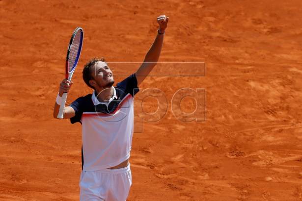 Daniil Medvedev of Russia celebrates winning against reacts Stefanos Tsitsipas of Greece during their third round match at the Monte-Carlo Rolex Masters tournament in Roquebrune Cap Martin, France, 18 April 2018.  EPA-EFE/SEBASTIEN NOGIER