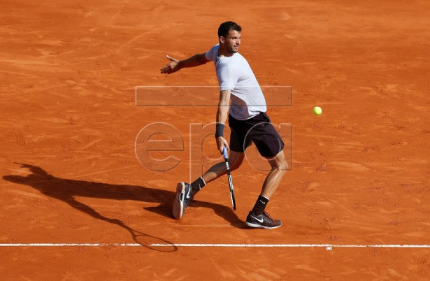 Grigor Dimitrov of Bulgaria in action during his third round match against Rafael Nadal of Spain at the Monte-Carlo Rolex Masters tournament in Roquebrune Cap Martin, France, 18 April 2018.  EPA-EFE/SEBASTIEN NOGIER