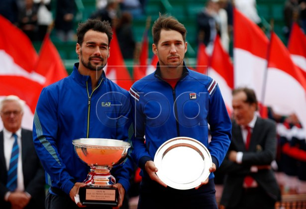 Winner Fabio Fognini of Italy (L) poses with his trophy next to runner up Dusan Lajovic of Serbia (R) after the final match of the Monte-Carlo Rolex Masters tournament in Roquebrune Cap Martin, France, 21 April 2019.  EPA-EFE/SEBASTIEN NOGIER