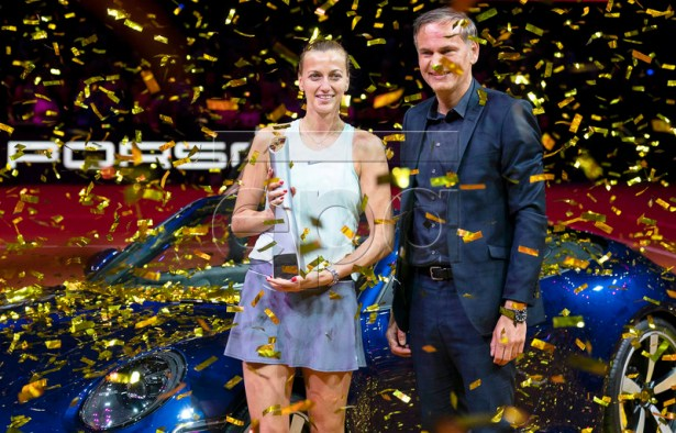 Petra Kvitova (L) of the Czech Republic poses with her trophy next to Porsche AG CEO Oliver Blume (R) after winning her final match against Anett Kontaveit of Estonia at the Porsche Tennis Grand Prix tournament in Stuttgart, Germany, 28 April 2019.  EPA-EFE/RONALD WITTEK
