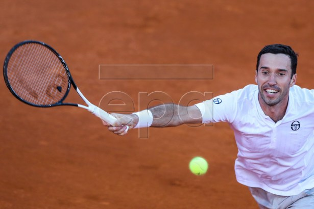 Mikhail Kukushkin from Kazakhstan in action during his first round martch against  Frances Tiafoe from the USA at the Estoril Open Tennis tournament in Cascais, near Lisbon, Portugal, 30 April 2019.  EPA-EFE/JOSE SENA GOULAO