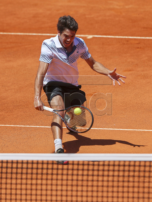 Joao Domingues of Portugal in action during his second round match against John Millman of Australia at the Estoril Open tennis tournament in Cascais, near Lisbon, Portugal, 01 May 2019.  EPA-EFE/JOSE SENA GOULAO