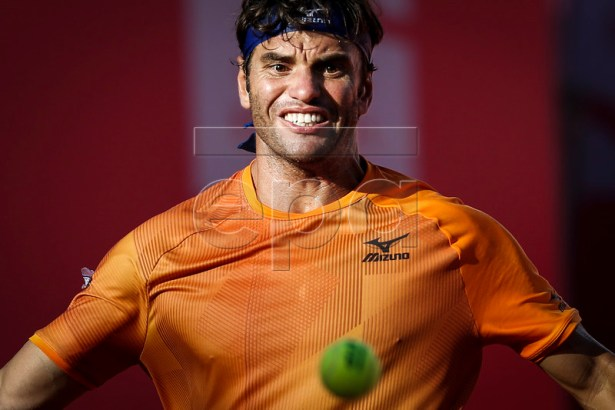 Malek Jaziri of Tunisia in action during his third round match of the Estoril Open Tennis tournament against Leonardo Mayer of Argentina, in Cascais, near Lisbon, Portugal, 02 May 2019.  EPA-EFE/RODRIGO ANTUNES