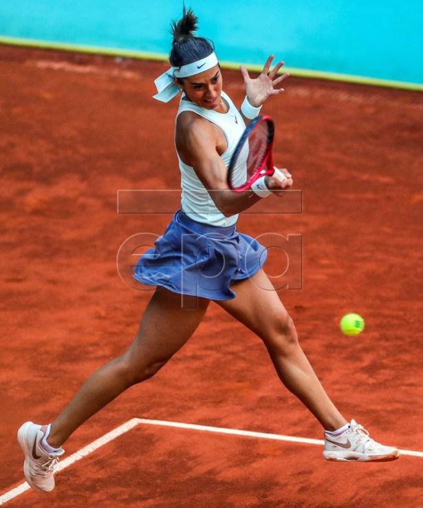 Caroline Garcia of France in action against Su-Wei Hsieh of Taiwan during their first round match of the Mutua Madrid Open 2019 tennis tournament at Caja Magica in Madrid, Spain, 04 April 2019. EPA-EFE/JUANJO MARTIN