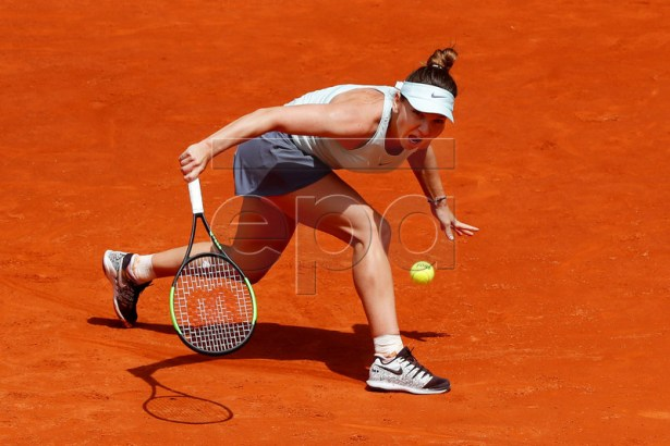 Simona Halep of Romania in action against Johanna Konta of Britain during their second round match of the Mutua Madrid Open tennis tournament at the Caja Magica complex in Madrid, Spain, 07 May 2019.  EPA-EFE/CHEMA MOYA