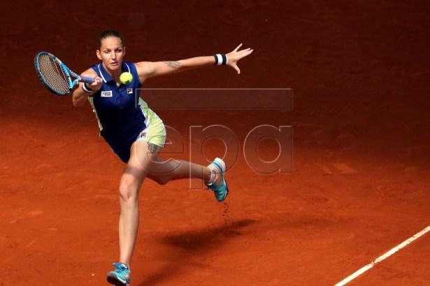Czech player Karolina Pliskova in action during her second round match against Ukraine's Kateryna Kozlova at the Mutua Madrid Open tennis tournament in Madrid, Spain, 07 May 2019.  EPA-EFE/KIKO HUESCA