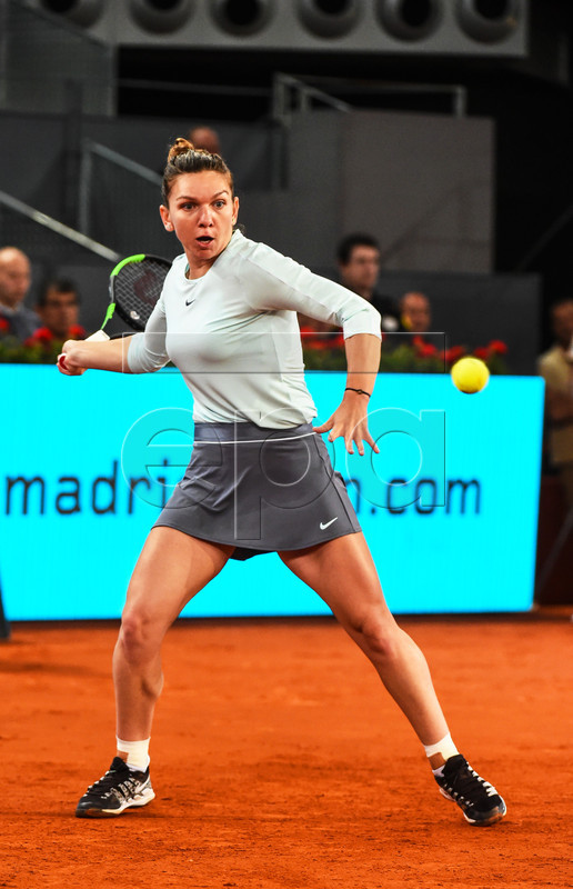 Simona Halep of Romania in action against Viktoria Kuzmova of Slovakia during their third round match of the Mutua Madrid Open tennis tournament at the Caja Magica complex in Madrid, Spain, 08 May 2019. EPA-EFE/FERNANDO VILLAR