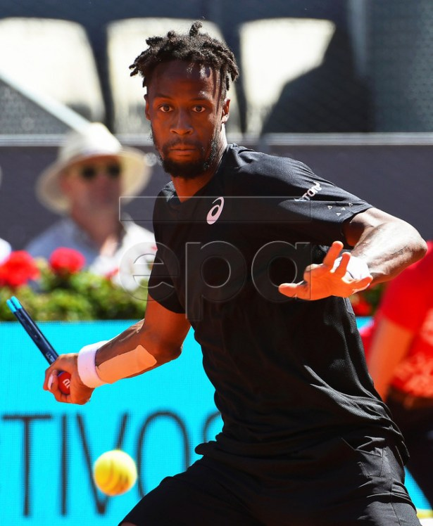 Gael Monfils of France in action against Roger Federer of Switzerland during their third round match of the Mutua Madrid Open tennis tournament at the Caja Magica complex in Madrid, Spain, 09 May 2019.  EPA-EFE/FERNANDO VILLAR