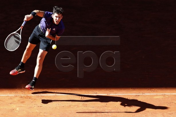 Austria's Dominic Thiem in action during his quarter final match against Switzerland's Roger Federer at the Mutua Madrid Open tennis tournament in Madrid, Spain, 10 May 2019.  EPA-EFE/JAVIER LIZON