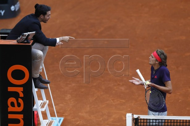 Alexander Zverev of Germany argues with the umpire during during his quarter final match against  Stefanos Tsitsipas of Greece at the Mutua Madrid Open tennis tournament in Madrid, Spain, 10 May 2019.  EPA-EFE/JAVIER LIZON