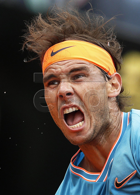 Rafael Nadal of Spain in action against Stefanos Tsitsipas of Greece during their men's singles semi final match at the Italian Open tennis tournament in Rome, Italy, 18 May 2019. EPA-EFE/RICCARDO ANTIMIANI