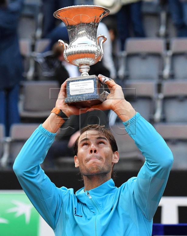 Rafael Nadal of Spain lifts his trophy after defeating Novak Djokovic of Serbia in their men's singles final match at the Italian Open tennis tournament in Rome, Italy, 19 May 2019.  EPA-EFE/ETTORE FERRARI